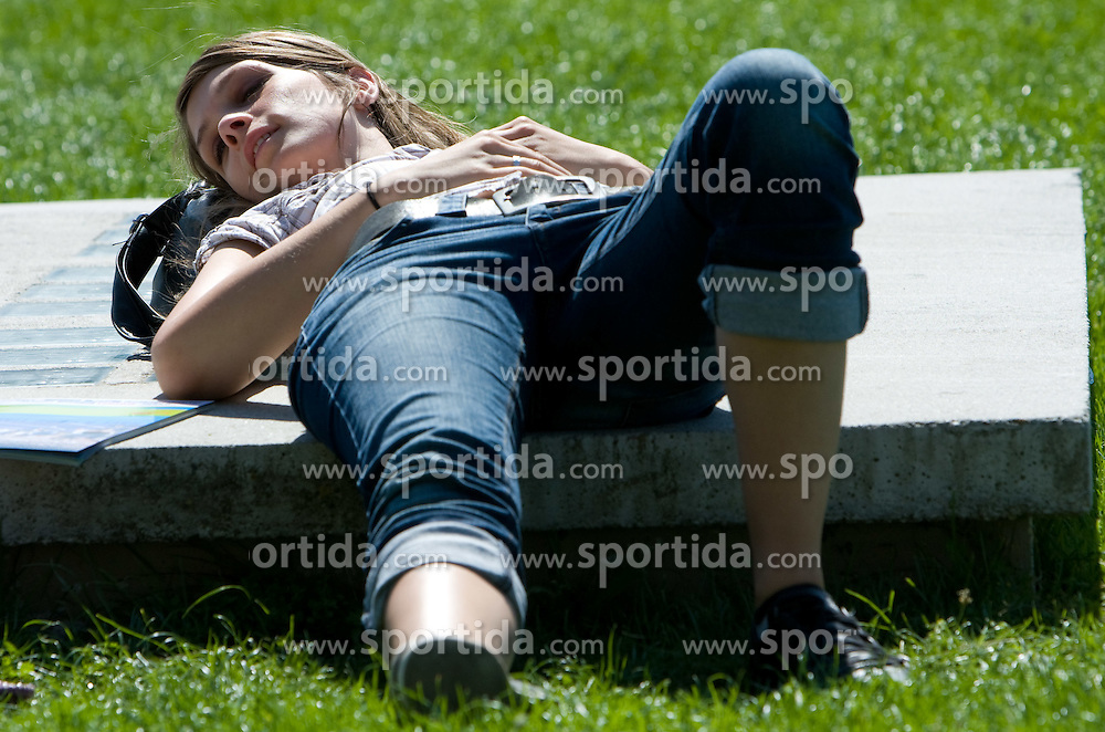 Girl resting outside of the stadium during day two of the 12th 2009 IAAF Athletics World Championships on August 16, 2009 in Berlin, Germany. (Photo by Vid Ponikvar / Sportida)