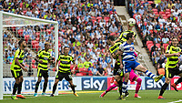 Football - 2016 / 2017 Championship Playoff Final: Reading vs. Huddersfield<br /> <br /> Aaron Mooy of Huddersfield Town rises highest to clear a Reading corner at Wembley Stadium.<br /> <br /> COLORSPORT/DANIEL BEARHAM