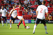 Charlton Athletic forward Josh Magennis (9) dribbling during the EFL Sky Bet Championship match between Charlton Athletic and Bolton Wanderers at The Valley, London, England on 27 August 2016. Photo by Matthew Redman.