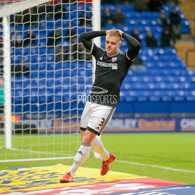 Jake Bidwell (Brentford) holds his head in his hands as he heads just wide with an easy chance to increase Brentfords lead during the Sky Bet Championship match between Bolton Wanderers and Brentford at the Macron Stadium, Bolton, England on 30 November 2015. Photo by Mark P Doherty.