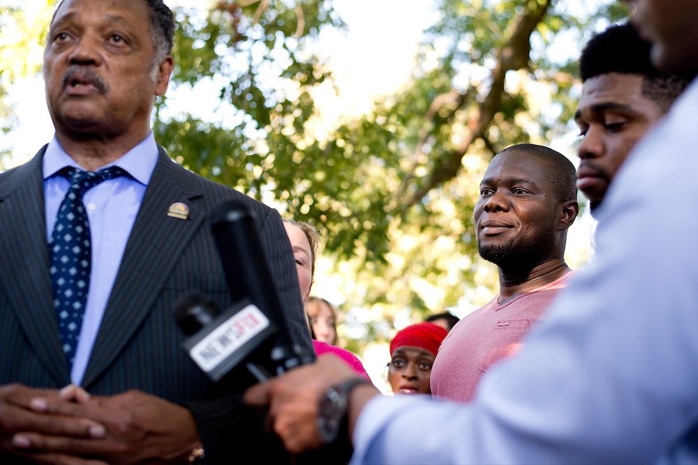 Josephus Weeks, nephew of Ebola patient Thomas Eric Duncan, looks on while Rev. Jesse Jackson answers questions during a prayer vigil for Duncan at Texas Health Presbyterian Hospital on October 7, 2014, in Dallas. (Cooper Neill for The New York Times)
