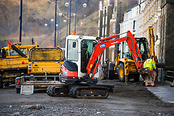 © Licensed to London News Pictures. 07/01/2014. Aberystwyth, UK. As the stormy weather subsides, the full impact of several days of huge tides and massive waves becomes clear to see on Aberystwyth promenade, Wales UK. Workmen begin the long process of clearing up the debris and making the area safe and secure. Photo credit : Keith Morris/LNP