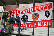 Salford City fans before the match.  EFL Sky Bet League 2 match between Salford City and Macclesfield Town at the Peninsula Stadium, Salford, United Kingdom on 23 November 2019.