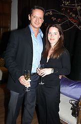 DR MAURIZIO VIEL and LISA ROBERTS at the AJM International Publishing Party to celebrate 4 years as publishers of PrivatAir Magazine and the Cartier International Polo Magazine held at Rooms Eleven, 11 Grosvenor Place, London on 24th May 2005.<br />
