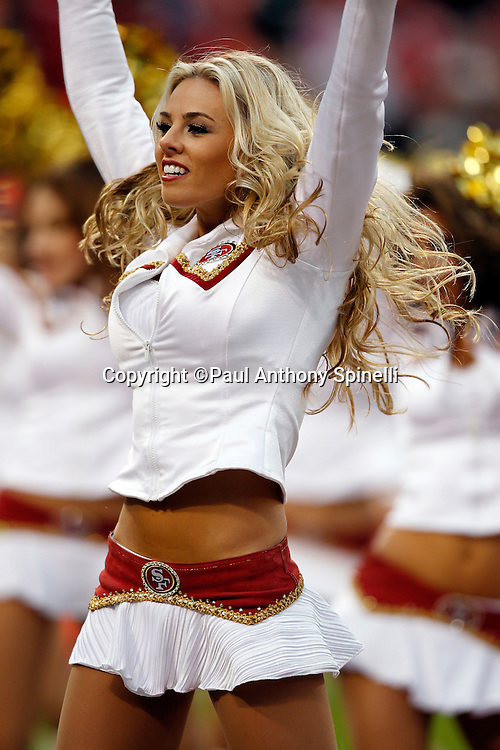 A San Francisco 49ers cheerleader smiles during a dance routine during the NFL week 17 football game against the Arizona Cardinals on Sunday, January 2, 2011 in San Francisco, California. The 49ers won the game 38-7. (©Paul Anthony Spinelli)