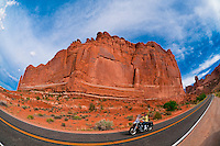 Women riding Harleys through Arches National Park, near Moab, Utah USA