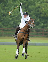 LONDON, UK: The Duke of Cambridge and Prince Harry play in the Sentebale Polo Cup at Coworth Park, Windsor, on the 12th June 2011..PHOTOGRAPH BY JAMES WHATLING