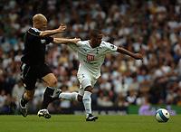 Photo: Tony Oudot.<br /> Tottenham Hotspur v Derby County. The FA Barclays Premiership. 18/08/2007.<br /> Wayne Routledge of Tottenham goes past Jay McEveley of Derby County