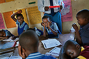 Grade three (age 8-9) children at the Mutenda Primary School in drought-hit Masvingo Province, Zimbabwe, collapse from hunger and exhaustion during class. <br /> <br /> Drought in southern Africa is devastating communities in Zimbabwe, leaving 4 million people urgently in need of food aid. The government declared a state of emergency,. <br /> <br /> Here in Masvingo Province, the country's hardest hit province, vegetation has wilted, livestock is dying, and people are at serious risk of famine. <br /> <br /> Pictures shot by Justin Jin