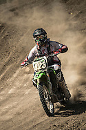 Andy Dunaway photographed Motor Cross at the Aztec Race Track during the Clarkson Sports Workshop in Colorado Springs, Colo, on July 20, 2013. Andy used an Nikon D4, 80-400mm, XQD card. This picture Andy used Nikon NX2 to enhance the face and decrease brightness on the bikes number plate.