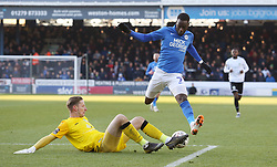 Lee Worgan of Dover Athletic tackles Mohamed Eisa of Peterborough United - Mandatory by-line: Joe Dent/JMP - 01/12/2019 - FOOTBALL - Weston Homes Stadium - Peterborough, England - Peterborough United v Dover Athletic - Emirates FA Cup second round