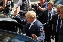 © Licensed to London News Pictures. 22/07/2019. London, UK. Media and police surround Conservative Party leadership candidate BORIS JOHNSON as he leaves his campaign headquarters in Westminster, London. This week the Conservative Party will select a new leader and Prime Minister, following Theresa May's announcement that she will step down. Photo credit: Ben Cawthra/LNP