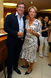 JOHN & ANOUSKA AYTON of Links of London at a party hosted by Links at their store in Sloane Square, London to celebrate the forthcoming Glorious Goodwood Racing festival held on 26th July 2006.<br /><br />NON EXCLUSIVE - WORLD RIGHTS