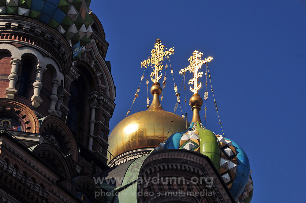 Crosses gleam in the morning sun on the Church of Our Savior on the Spilled Blood in St. Petersburg, Russia. Closed for restoration for nearly 30 years, it reopened in 1997.