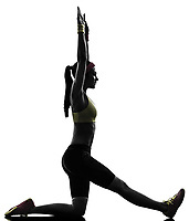 one woman exercising fitness workout balance stretching in silhouette on white background