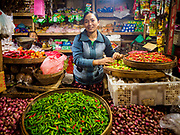 04 AUGUST 2017 - PAYANGAN, BALI, INDONESIA: A chili seller in the local market in Payangan, about 45 minutes from Ubud. Bali's local markets are open on an every three day rotating schedule because venders travel from town to town. Before modern refrigeration and convenience stores became common place on Bali, markets were thriving community gatherings. Fewer people shop at markets now as more and more consumers go to convenience stores and more families have refrigerators.      PHOTO BY JACK KURTZ