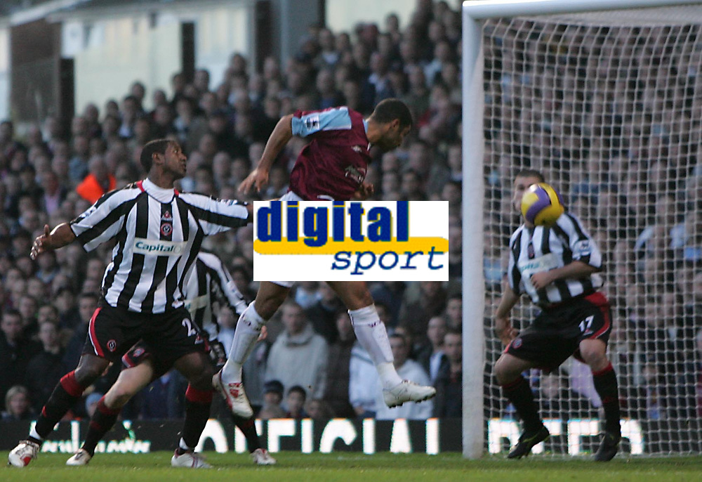 Photo: Lee Earle.<br /> West Ham United v Sheffield United. The Barclays Premiership. 25/11/2006. West Ham's Hayden Mullins (C) heads home their opening goal.