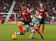Picture by Tom Smith/Focus Images Ltd 07545141164<br /> 26/12/2013<br /> Ryan Fraser (centre) of Bournemouth is tackled by Kevin Dawson (2nd right) of Yeovil Town during the Sky Bet Championship match at the Goldsands Stadium, Bournemouth.