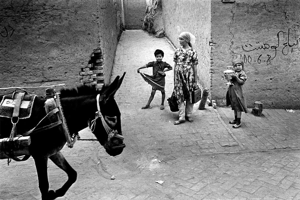 Xinjiiang Uygur Autonomous region. Kashgar. Children returning home from market in Kashgar.