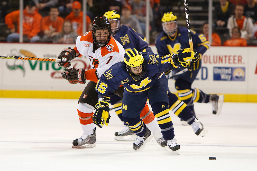 November 21, 2009:  BGSU's James Perkin (7) and Michigan's Anthony Ciraulo (15) during the NCCA hockey game between Michigan and the Bowling Green State University at Lucas County Arena in Toledo, Ohio.