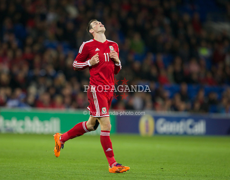 CARDIFF, WALES - Saturday, November 16, 2013: Wales' Gareth Bale in action against Finland during an International Friendly match at the Cardiff City Stadium. (Pic by Kieran McManus/Propaganda)