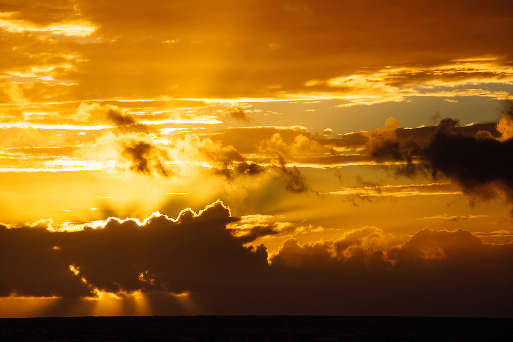 The sun setting behind clouds into the Indian Ocean along the Cape To Cape Track. Leeuwin-Naturaliste National Park.