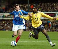 Photo: Ed Godden.<br />Portsmouth v Arsenal. The Barclays Premiership. 12/04/2006. Pompey's Svetoslav Todorov (L) tussles with Arsenal's Johan Djourou.