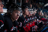 KELOWNA, CANADA - FEBRUARY 9: Colby McAuley #14 of Prince George Cougars sits on the bench against the Kelowna Rockets on February 9, 2015 at Prospera Place in Kelowna, British Columbia, Canada.  (Photo by Marissa Baecker/Shoot the Breeze)  *** Local Caption *** Colby McAuley;