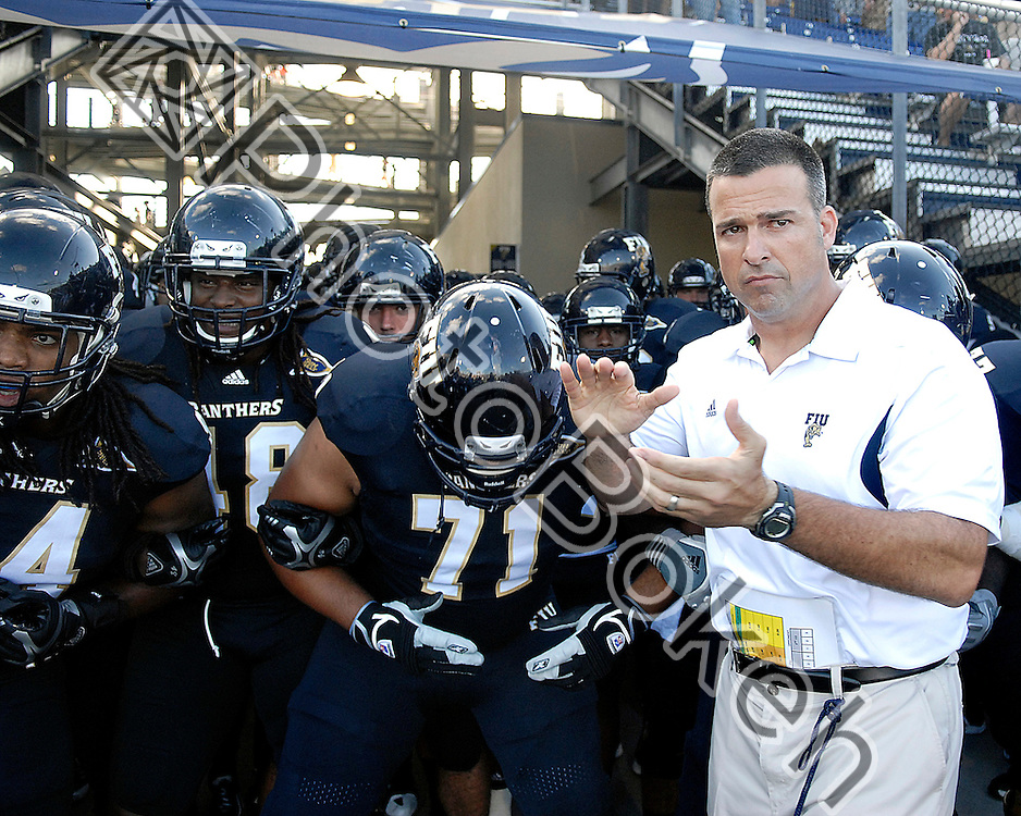 2011 September 17 - Coach Mario Cristobal waits for his team to be released into the Cage. Florida International University Golden Panthers defeated the Golden Knights of the University of Central Florida, 17-10, at the FIU Football Stadium, Miami, Florida. (Photo by: www.photobokeh.com / Alex J. Hernandez)