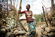 Asefu Reade, 18, in front of her home in Adi Sibhat, Tigray, Ethiopia.