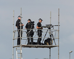 Pictured: police snipers await the arrival.<br /> <br /> President of the United States of America Donald Trump touched down at Prestwick Airport in Scotland at the start of a three day break at his golf resort at Turnberry. The President, accompanied by First Lady Melania Trump, was greeted on his first visit to Scotland as US President by Scottish Secretary David Mundell.<br /> <br /> © Dave Johnston / EEm