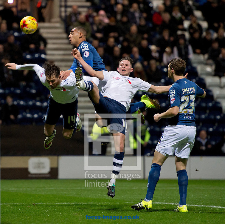 Joe Garner of Preston North End (left), James Vaughan of Birmingham City (2nd left) and Alan Browne of Preston North End (2nd right) all jump for the same ball during the Sky Bet Championship match at Deepdale, Preston<br /> Picture by Russell Hart/Focus Images Ltd 07791 688 420<br /> 15/12/2015