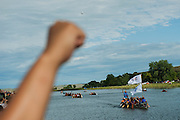 People raise their fists in the air in solidarity as a group of canoes arrives in a protest camp that sprang up to demonstrate against the Energy Transfer Partners' Dakota Access oil pipeline near the Standing Rock Sioux reservation in Cannon Ball, North Dakota. The canoe flotilla had representatives of tribes from the across the Pacific Northwest and navigated the Missouri River from Bismarck to Cannon Ball to show their support.