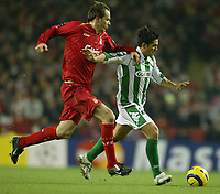 Photo: Aidan Ellis.<br /> Liverpool v Real Betis. UEFA Champions League.<br /> 23/11/2005.<br /> Liverpool's Dietmar Hamann chases down Betis Xisco