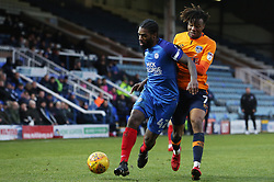 Anthony Grant of Peterborough United in action with Kundai Benyu of Oldham Athletic - Mandatory by-line: Joe Dent/JMP - 20/01/2018 - FOOTBALL - ABAX Stadium - Peterborough, England - Peterborough United v Oldham Athletic - Sky Bet League One