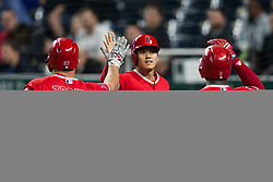 April 13, 2018 - Kansas City, MO, U.S. - KANSAS Kansas City, MO - APRIL 13:  Los Angeles Angels Starting pitcher Shohei Ohtani (17) celebrates with teammates Los Angeles Angels Center field Mike Trout (27) and Los Angeles Angels Left field Justin Upton (8) during the MLB regular season game between the Kansas City Royals and the Los Angeles Angels on Friday April 13th, 2018 at Kauffman Stadium in Kansas City, MO.  (Photo by Nick Tre. Smith/Icon Sportswire) (Credit Image: © Nick Tre. Smith/Icon SMI via ZUMA Press)