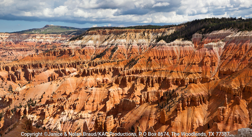 Cedar Breaks National Monument in Utah at altitudes above 10,000 feet provides impressive views of deep carved canyons with rock formations and hoodoos.