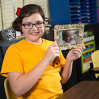 Lauren Wood | Buy at photos.djournal.com<br /> Sadie Randolph, 10, holds a photo of her late cousin Malaya whom she raised money for during her birthday party on February 5th in Belmont. Sadie had princesses and superheroes at the party and sold cupcakes, and raised $2,700 which she will donate to St. Jude Children's Research Hospital in Memphis.