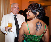 Temporary tattoo of Edwin Edwards on back of guest before Edwin Edwards Roast at the Hotel Monteleone; New Orleans, Louisiana