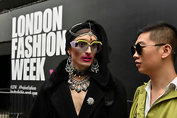 © Licensed to London News Pictures. 14/09/2018. LONDON, UK.  Fashionistas gather outside the home of London Fashion Week in The Strand as London Fashion Week SS19 opens.  Shows featuring many established and up and coming designers are taking place across the capital.  Photo credit: Stephen Chung/LNP