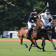 Action during the Airstream vs. Cinque Terre Polo match at the Greenwich Polo Club, Greenwich, Connecticut, USA. 23rd June 2013. Photo Tim Clayton