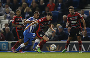 Huddersfield Town AFC midfielder Conor Coady gets away from Chris O'Grady, Brighton striker during the Sky Bet Championship match between Brighton and Hove Albion and Huddersfield Town at the American Express Community Stadium, Brighton and Hove, England on 14 April 2015.
