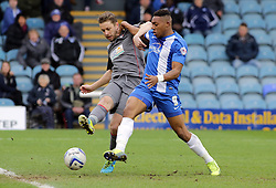 Peterborough United's Britt Assombalonga in action with Rotherham United's Kari Arnason - Photo mandatory by-line: Joe Dent/JMP - Mobile: 07966 386802 22/03/2014 - SPORT - FOOTBALL - Peterborough - London Road Stadium - Peterborough United v Rotherham United - Sky Bet League One