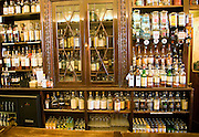 Specialist cabinet display whisky bottles, The Grill Bar, Aberdeen, Scotland