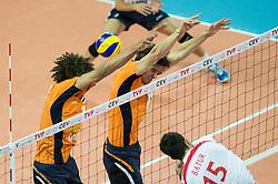 01-07-2012 VOLLEYBAL: EUROPEAN LEAGUE TURKIJE - NEDERLAND: ANKARA<br /> Nederland wint de European League 2012 door Turkije met 3-2 te verslaan / <br /> Nimir Abdel-Aziz (#1 NED), Wytze Kooistra (#12 NED) - Emre Batur (#15 TUR)<br /> ©2012-FotoHoogendoorn.nl/Conny Kurth
