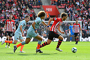 Manolo Gabbiadini (20) of Southampton on the attack during the Premier League match between Southampton and Chelsea at the St Mary's Stadium, Southampton, England on 7 October 2018.