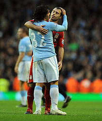 Javier Mascherano with Manchester City's Carlos Tevez after the final whistle of the Barclays Premier League match between Liverpool and Manchester City at Anfield - 21/11/09