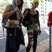 Protesters Sofia (left) and Kaysie, from Philadelphia, walk to the protest zone, during the Republican National Convention in Tampa, Fla. on Wednesday, August 29, 2012. (AP Photo/Alex Menendez)