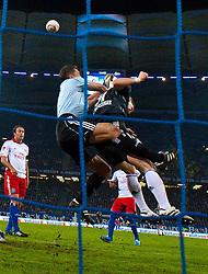 22.10.2010, Imtech Arena, Bremen, GER, 1.FBL, Hamburger SV vs Bayern Muenchen im Bild Zweikampf zwischen Bastian Schweinsteiger (Bayern #31) und Frank Rost (HSV #1) - hierbei verletzte sich der HSV Keeper am rechten Kn ie so schwer dass er kurz vor der Pause ausgewechselt werden musste     EXPA Pictures © 2010, PhotoCredit: EXPA/ nph/  Kokenge+++++ ATTENTION - OUT OF GER +++++
