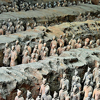 Description of Qin Shi Huang Mausoleum in Xi'an, China<br /> Construction of the final resting place for Zheng began in 246 BC shortly after he became the King of Qin at the age of 13. In 221 BC, he defeated the last of China's Warring States and was renamed Qin Shi Huang. During his eleven-year reign as the First Emperor of Qin (and China), approximately 700,000 men labored over his mausoleum. The project was finished in 208 BC, two years after the emperor's death. The measurements are staggering. At the center is an unexcavated mound shaped like a 250 foot tall subterranean pyramid. Encircling the emperor's tomb underground are a 1.5 mile inner city and a 3.9 mile outer city. Their design resembles Xianyang, the capital of the Qin dynasty. Archeologists estimate there are 600 burial sites within the surrounding 35 square miles. They contain the bodies of the royal family, government officials, high-ranking army members, concubines and mausoleum laborers. The impressive Terracotta Army seen in Pit Number One are only a fraction of this enormous complex. Simultaneous to the construction of the mausoleum, Qin Shi Huang ordered a massive extension of a defense along China's northern border. The 10,000-li Great Wall stretched for over 3,100 miles.